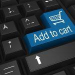 Computer keyboard, ''Add to cart'' written across the Enter button